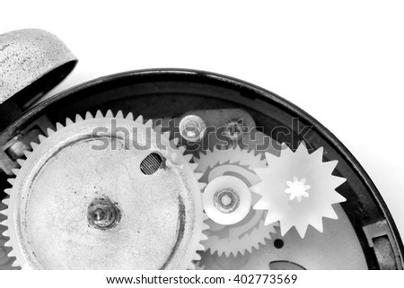 View of old and dirty alarm clock on white background. Black and white tone. Top view.
