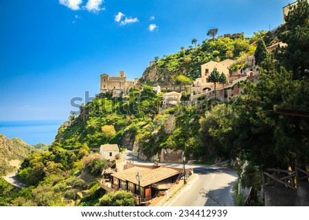 view of old buildings and Church of St. Nicolo in Savoca, small village near Taormina on the east side of Sicily, Italy - stock photo