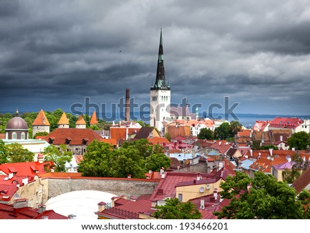 View of Old city's roofs in a thunder-storm. Tallinn. Estonia. - stock photo