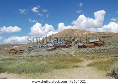 view of old gold mine in bodie ghost town, california - stock photo