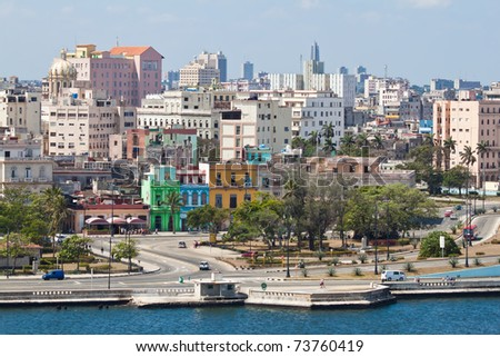 View of Old Havana with lots of colorful buildings and the bay in the foreground - stock photo