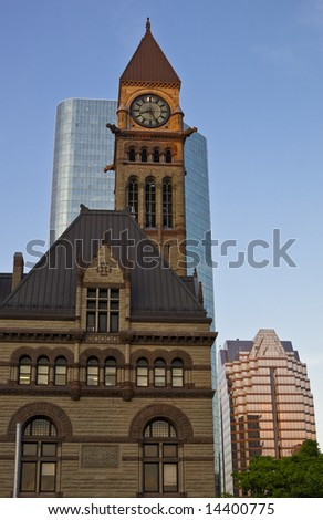 View of old historic Toronto city hall and the clock tower in front of the modern skyscraper at sunset [Adobe RGB] - stock photo