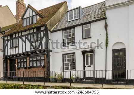 view of old houses in stone and wattle on a street in the historic village of Hastings, East Sussex   - stock photo
