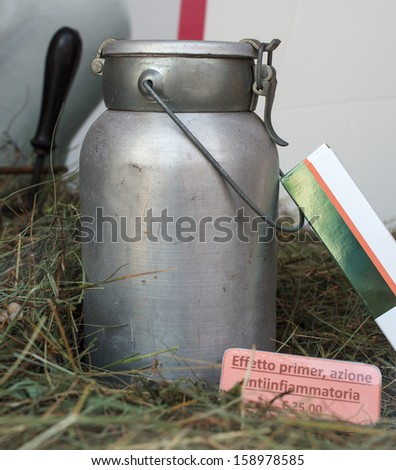 View of old iron milk can on the grass - stock photo