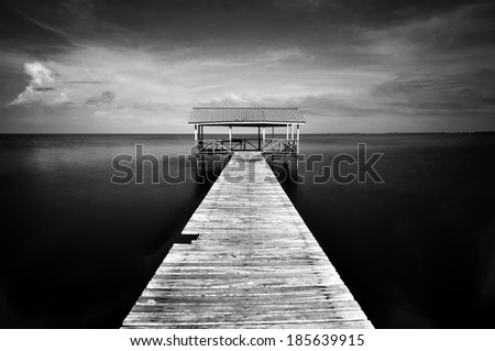 View Of Old Jetty in Black And White - stock photo