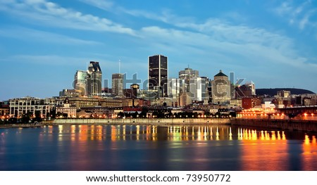 View of Old Montreal with a portion of the port, and office buildings in background at dusk. - stock photo