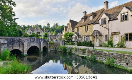 View of Old Riverside Cottages in a Beautiful Village - Namely the Landmark Castle Combe in Wiltshire England - stock photo