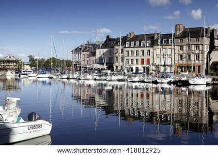 View of Old Town and Ships in Port at Honfleur Normandy France on October 10 2012 - stock photo
