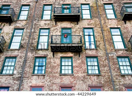 View of old wall and balconies in Savannah, Georgia. - stock photo