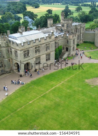 View of old Warwick castle from tower with isolated sky - stock photo
