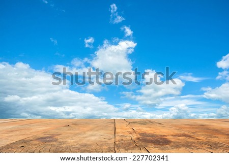 view of old wooden board with the sky - stock photo