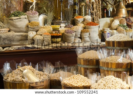 View of oriental Arabic spices put on wooden barrels on spice market. - stock photo
