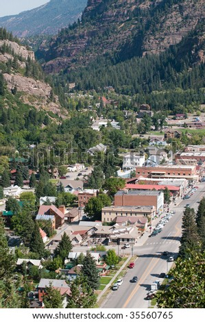 View of Ouray, Colorado from cliffs above town - stock photo
