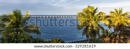 View of Overseas Highway framed by palm trees from historic Rail Bridge at Bahia Honda state park in Florida Keys, USA. - stock photo