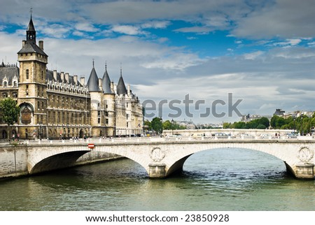 View of  Palais de Justice and a bridge over the Seine river. Paris, France. - stock photo