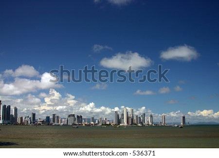 View of Panama City, Panama, with a blue sky and a contaminated sea. - stock photo
