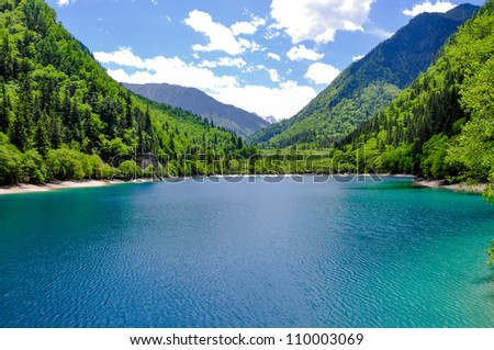 View of Panda Lake at Jiuzhaigou.  Jiuzhaigou is a nature reserve famous for its colorful lakes located in the Tibetan-Qiang, Sichuan. It is one of the most visited sites in China. - stock photo
