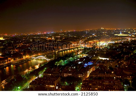View of Paris from Eiffel tower at night - stock photo