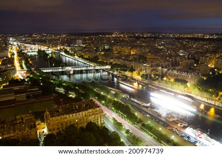 View of Paris from the Eiffel tower at night  - stock photo