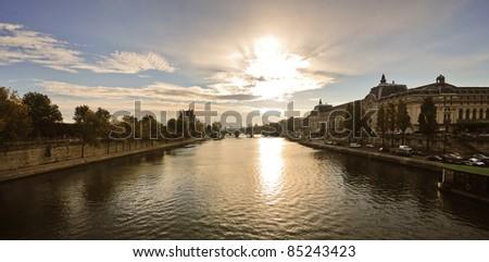 View of Paris Seine riverside at sunrise, d'Orsay museum - stock photo