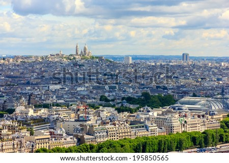 View of Paris, the hill Montmartre and the Sacre Coeur Basilica and from the Eiffel tower