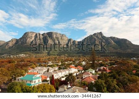 View of part of the Table Mountain range in Cape Town, South Africa, with residential suburbs on its slopes - stock photo