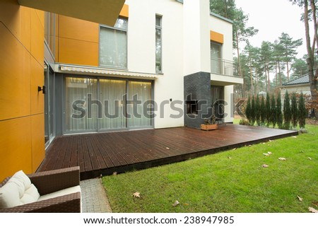 View of patio and garden during autumn time - stock photo