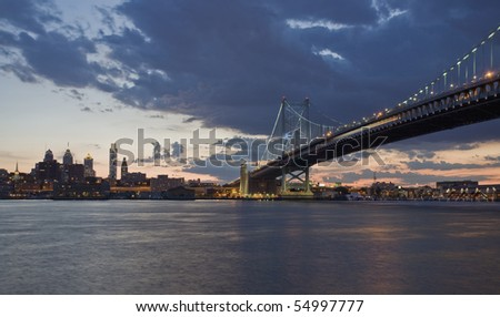 View of Philadelphia and the Benjamin Franklin Bridge over the Delaware River. - stock photo