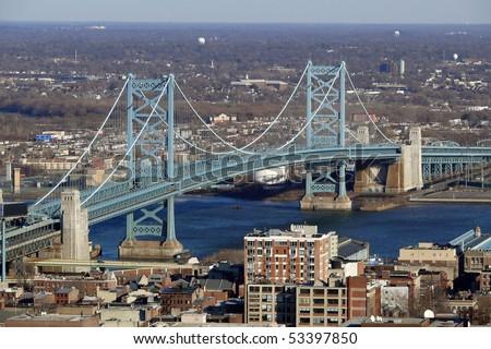 View of Philadelphia's Ben Franklin bridge with New Jersey beyond. - stock photo