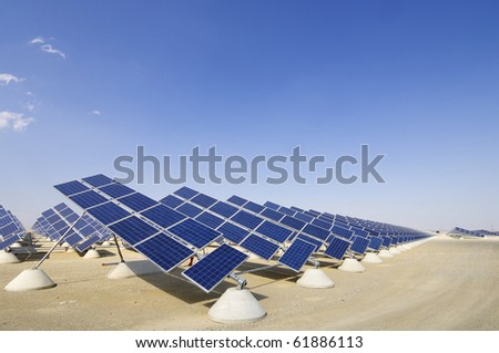 view of photovoltaic panels group with blue sky - stock photo