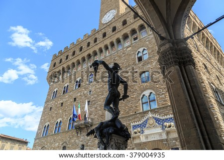 View of Piazza Della Signoria in Florence, with historical sculptures around, on cloudy blue sky background.