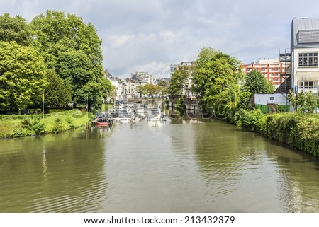 View of picturesque houses along channel. Ghent is a city and a municipality located in the Flemish region of Belgium. - stock photo