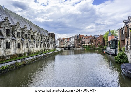View of picturesque houses along channel. Ghent is a city and a municipality located in the Flemish region of Belgium.