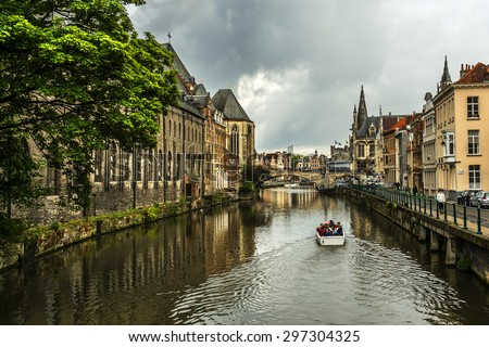View of picturesque houses along channel in Ghent. Ghent is a city and a municipality located in the Flemish region of Belgium. - stock photo