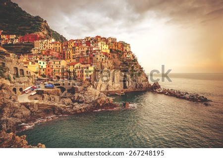 View of picturesque Manarola at sunset. Manarola is a small town in the province of La Spezia, Liguria, northern Italy.