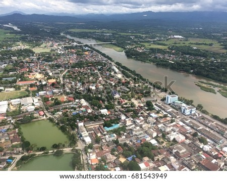 View of Ping's river and Tak's city in Thailand from aircraft.