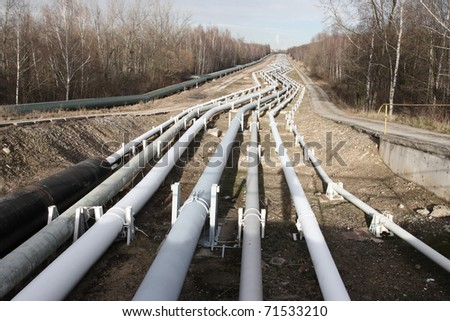 View of pipelines leading to the horizon with power-plant - stock photo