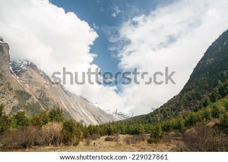 View of Pisang Valley, Nepal, Himalayas. Pisang is a part of Annapurna Circuit Trek, one of the most popular adventure circuit trek in the world. - stock photo