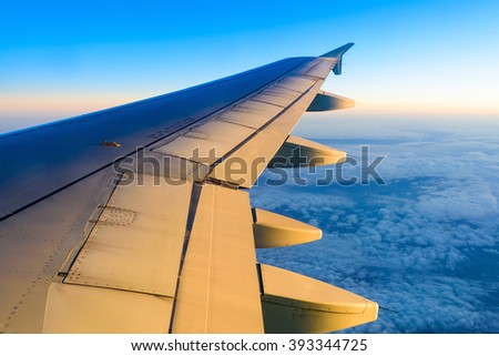 view of planet earth from an airplane through the window - stock photo