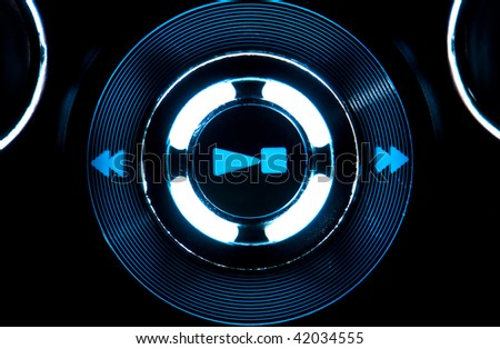 View of play, stop, symbol control of mp3 player with blue light. - stock photo