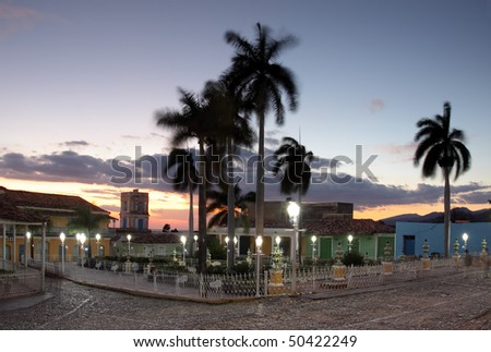 view of plaza mayor in trinidad, cuba at dusk - stock photo