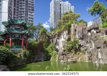 View of pond and Hexagonal Pavilion at the Sik Sik Yuen Wong Tai Sin Temple in Hong Kong, China. - stock photo