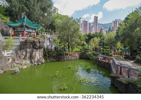 View of pond and Square Pavilion at the Sik Sik Yuen Wong Tai Sin Temple in Hong Kong, China. - stock photo