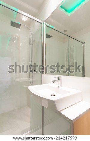 View of porcelain sink in modern bathroom