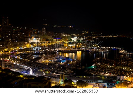 View of Port Hercule and the city at night. Monte Carlo, Principality of Monaco, France, Europe - stock photo