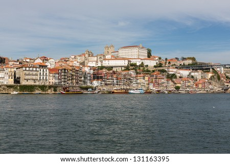 View of Porto city at the riverbank (Ribeira quarter) and wine boats(Rabelo) on River Douro(Portugal), a UNESCO World Heritage City.