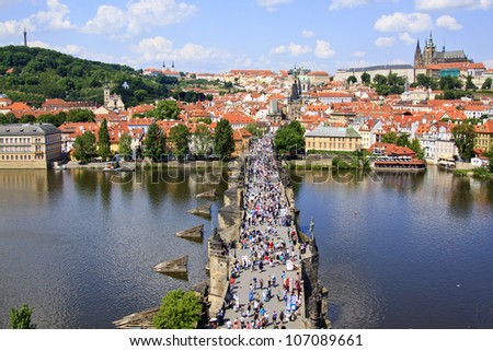 View of Prague, Charles bridge, Vltava river, St. Vitus cathedral, Petrin hill and Strahov Monastery - stock photo