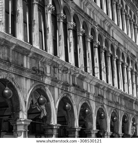 View of Procuratie Vecchie - building in gothic style on St Marks Square. Black and white photography. - stock photo