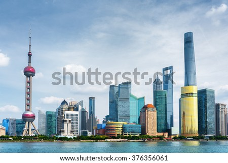 View of Pudong skyline (Lujiazui) in Shanghai, China. Skyscrapers of downtown on waterfront. The Shanghai World Financial Center (SWFC) is visible at right, the Oriental Pearl Tower at left. - stock photo