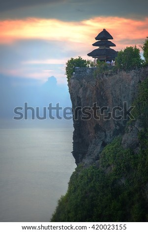 View of Pura Uluwatu cliff, Pura Uluwatu is a Balinese sea temple in Uluwatu in Bali, Indonesia - stock photo